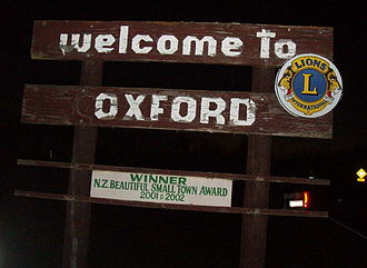 "Oxford, New Zealand - ""Welcome to Oxford"" sign, with ""NZ Beautiful Small Town"" claim"