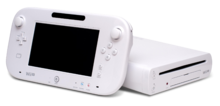 A white Wii U console and gamepad.