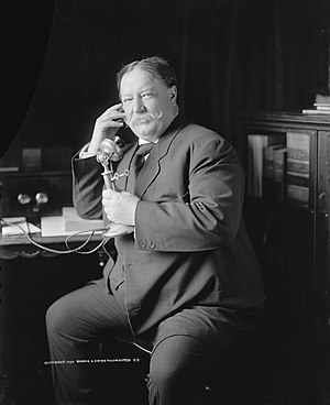 William Howard Taft - One of a series of candid photographs known as the Evolution of a Smile, taken just after a formal portrait session, as Taft learns by telephone from Roosevelt of his nomination for president.