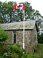 Wolford Chapel and Canadian flag 7902612172.jpg
