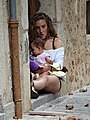 Woman with Child - Soller - Mallorca - Spain (14511605674).jpg