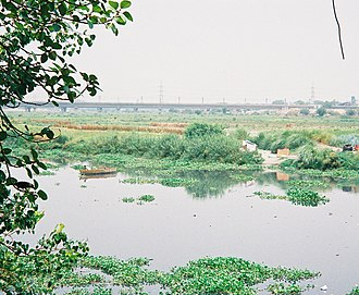 Salimgarh Fort - View of Yamuna River from the Salimgarh Fort with railway bridge in the background