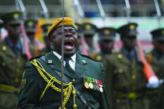 Zimbabwe National Army - An officer of the Presidential Guard commanding a parade.