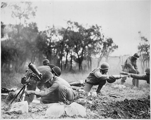 "By the end of 1944, the replacements made with troops of the U.S. 92nd Infantry Division (photo) and the Brazilian division, still hadn't covered the hole left by those diverted to Southern France. ""Members of a Negro mortar company of the 92nd Division pass the ammunition and heave it over at the Germans in an almos - NARA - 535546.jpg"