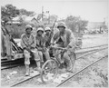 """Negro Marines, attached to the Third Ammunition Company, take time out from supplying ammunition to the front line on S - NARA - 532531.tif"