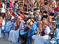 Домбристы во время концерта сводного оркестра домбристов, Элиста, 14.06.2015.jpg
