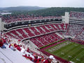 Donald W. Reynolds Razorbacks Stadium contains Frank Broyles Field, where the football team represents the University.