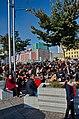 0905 - Nordkorea 2015 - Pjöngjang - Public Viewing am Bahnhofsplatz (22789371360).jpg