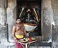 1010 CE Brihadishwara Shiva Temple, Ganesha with pujari, built by Rajaraja I, Thanjavur Tamil Nadu India.jpg