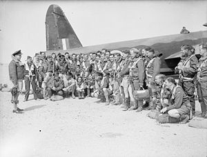 No. 108 Squadron RAF - Wing Commander R. J. Wells (far left), Commanding Officer of No. 108 Squadron, addresses his crews in front of a Vickers Wellington Mark IC, before taking off from RAF Fayid, Egypt, on an operation.