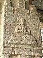 15th-16th century Achyutaraya temple yogi in namaste pose, Hampi Hindu monuments Karnataka.jpg