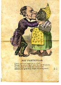 """This racist postcard from the 1900s shows the casual denigration of black women. It states """"I know you're not particular to a fault / Though I'm not sure you'll never be sued for assault / You're so fond of women that even a wench / Attracts your gross fancy despite her strong stench"""""""
