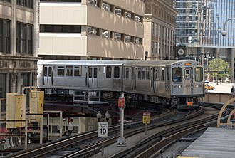 "Chicago ""L"" - A Pink Line train approaches Randolph/Wabash."