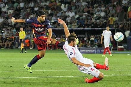 Suarez strikes against Sevilla in the 2015 UEFA Super Cup. 2015 UEFA Super Cup 79.jpg