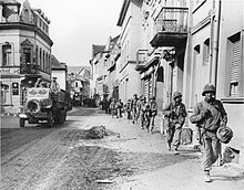 American Soldiers march through a German town in 1945