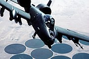 USAF A-10A Thunderbolt-II ground attack plane over circles of irrigated crops during Desert Storm.