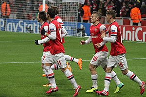 Jack Wilshere - Wilshere (second from right) celebrating a goal for Arsenal in 2013