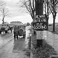 A British jeep passes a sign warning against looting on the outskirts of Ravenna, Italy, 7 December 1944. NA20577.jpg