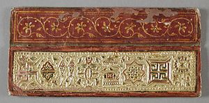 Jain symbols - Ashtamangala, according to Svetambara tradition, on Jain manuscript cover, LACMA (from left) : Swastika, Vardhmanaka, Pair of fish, Kalasha, Bhadrasana, Srivatsa, Nandavarta, Darpan