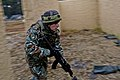 A Macedonian soldier enters and clears a building during a military adviser team (MAT) and police adviser team (PAT) training exercise at the Hohenfels Training Area, a part of the Joint Multinational Readiness 131214-A-HJ139-005.jpg