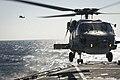 A Turkish Navy S-70B Seahawk lands aboard USS Porter. (26107664716).jpg