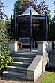 A gazebo with bench and trellis Capel Manor College Gardens Enfield London England.jpg
