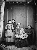 A group including a woman and four children NLW3364713.jpg