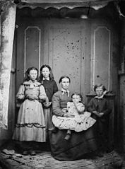 A group including a woman and four children