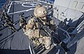 A member of the Armed Forces of Malta climbs a ladder during a VBSS.jpg