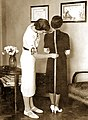 A tailor fitting a customer (Belgrade, 1937).jpg