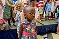 A young Girl Listens as Secretary Kerry Addresses Staff and Family Members at the U.S. Embassy in Kigali (30326380655).jpg
