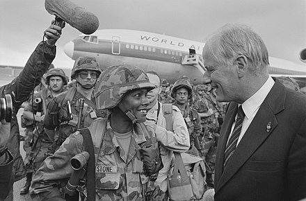 Wim van Eekelen, Minister of Defence of the Netherlands, greeting US soldiers deploying to NATO bases in 1987