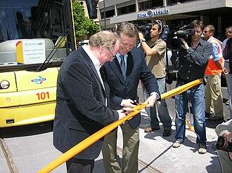 Patrick Conlon (politician) - Pat Conlon (left) and Mike Rann opening the extension of the Glenelg Tramline in October 2007.
