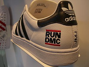 The Adidas shoe with the logotype ogа the hip-...