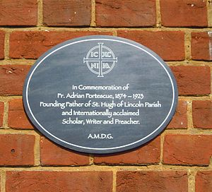 Adrian Fortescue - A plaque to Adrian Fortescue on the side of Fortescue Hall at the Church of St Hugh of Lincoln in Letchworth