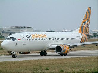 Air Polonia - An Air Polonia Boeing 737-400 taxiing at Malta International Airport, Malta. (2003)