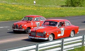 Historic motorsport - A Saab 96 (left) and a Volvo Amazon (right) line up to race.