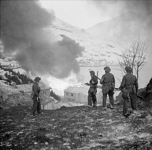 Ammunition dump - Raid on Vågsøy, 27 December 1941. British commandos watch as an ammunition dump burns. (Operation Archery)