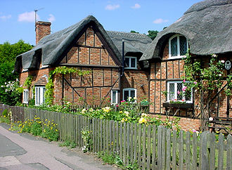 Cottage garden - Vernacular thatched cottages (built in 1812–1816) in Woburn Street, Ampthill, Bedfordshire, surrounded by garden.