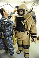 An Iraqi explosive ordnance disposal (EOD) soldier loosens the neck padding of an EOD bomb disposal suit during EOD training in the Kirkuk province of Iraq Aug. 28, 2010 100828-A-DM673-361.jpg