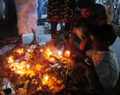 An offering at Chaitya Bhoomi by family.png