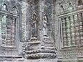 Angkor - Ta Prohm - 017 Apsaras and False Windows (8581948456).jpg