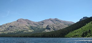 Mount Henry (Montana) - Appistoki at left and Mount Henry at right rise above Two Medicine Lake