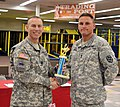 Army Command Sgt. Maj. Ronnie R. Kelley, left, command sergeant major for 1st Armored Division and Fort Bliss, presents the first place trophy to Sgt. 1st Class Matthew Biggs, a Non-commissioned officer, from 121119-A-KJ276-003.jpg