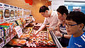 Asian Family Customers Shopping in The Super Market.jpg