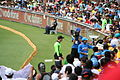 Australia v India Sachin signing autographs for fans (6931216989).jpg