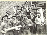 Australian naval gunners with 4.7 inch ammunition 1944 AWM 016472