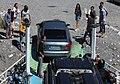 Autofähre am Komanisee - Autos fahren von der Fähre.jpg