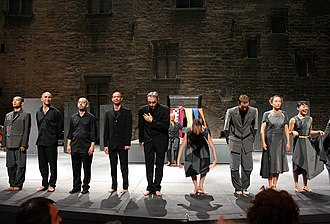 Festival d'Avignon - A main venue of the 60th (2006) Avignon Theatre Festival staged at the Palais des Papes, featuring Asobu, a play by the festival artistic associate Josef Nadj (fifth from the left).