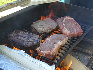 Beef steaks over wood